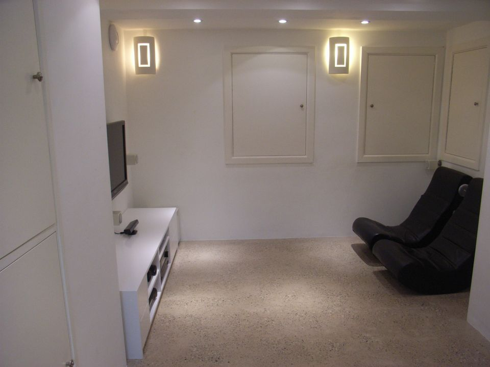 basement conversion for home cinema with gaming chairs
