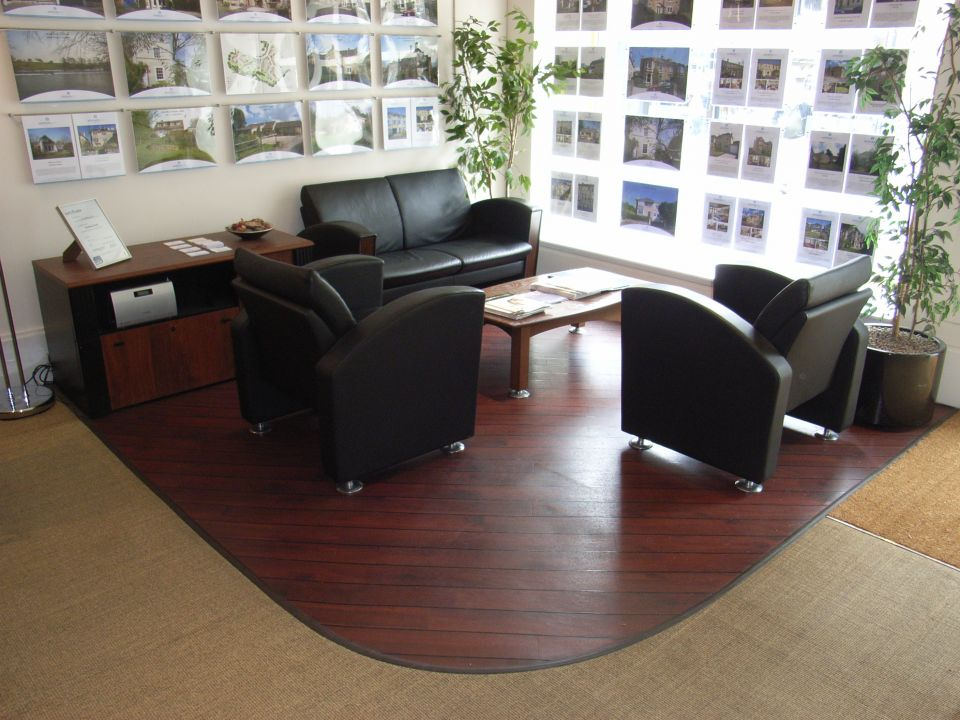 commercial interior design; here is an estate agent's office where agents andd clients sit comfortably to review properties
