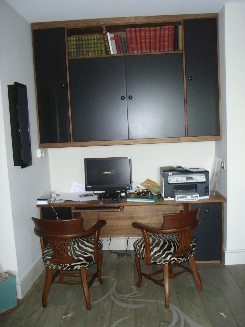 home office bepoke desk and storage in american dark walnut with black eggshell doors