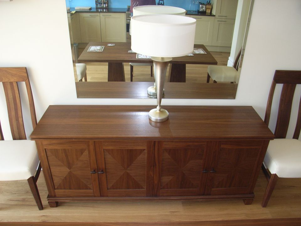 large silvered table lamp on sideboard
