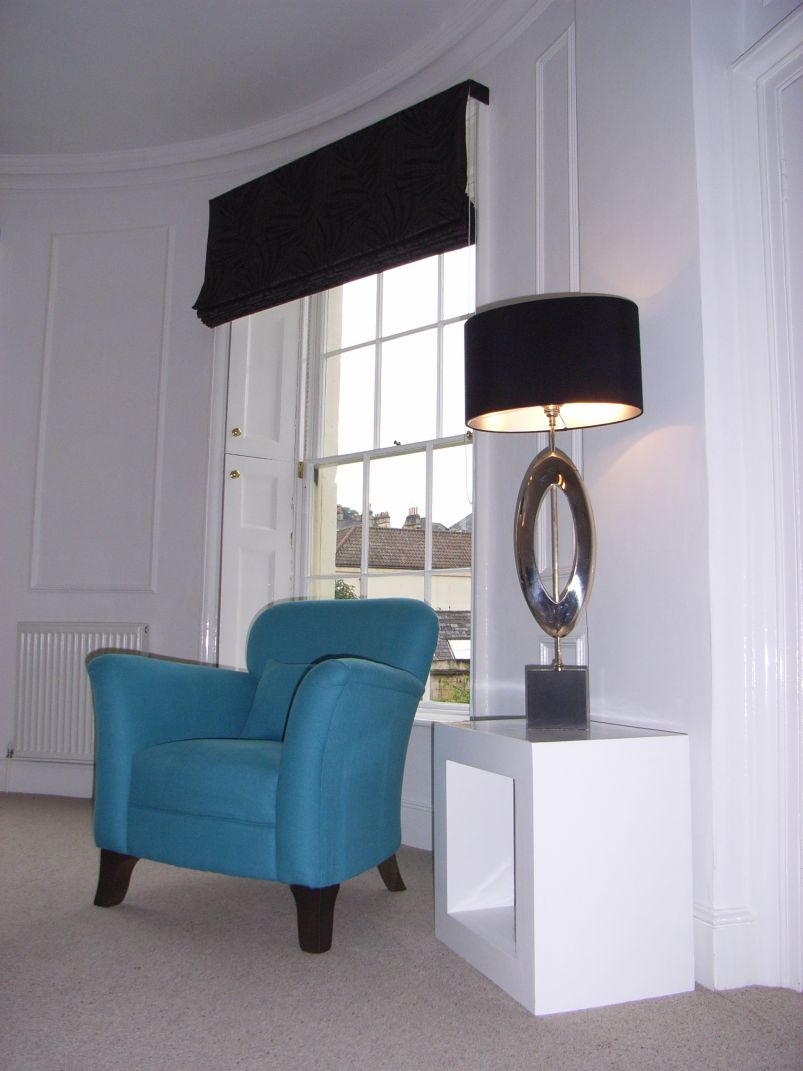architectural table lamp with blue chair