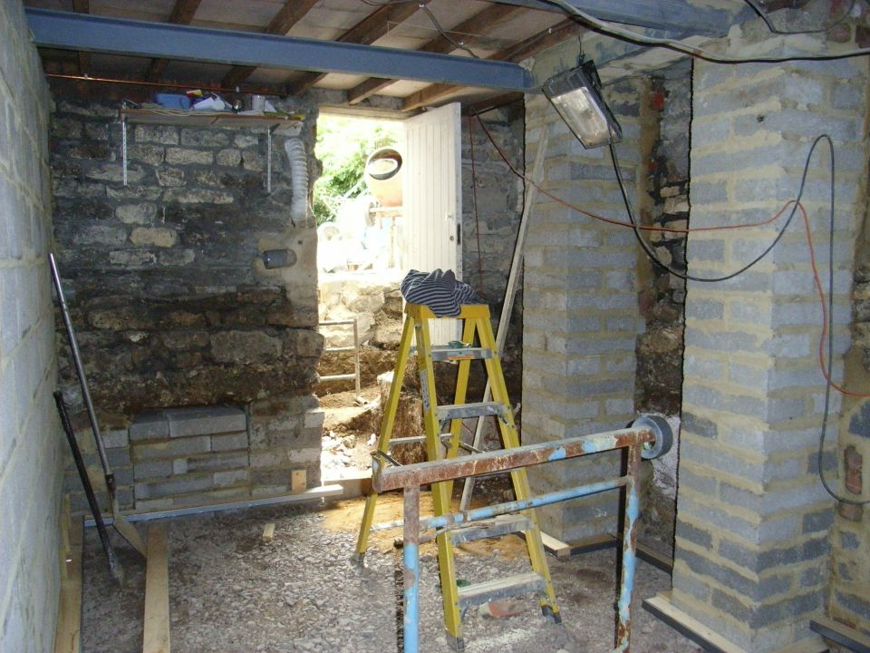 underpinning for basement conversion; two pillars are supporting the fireplace hearth above.
