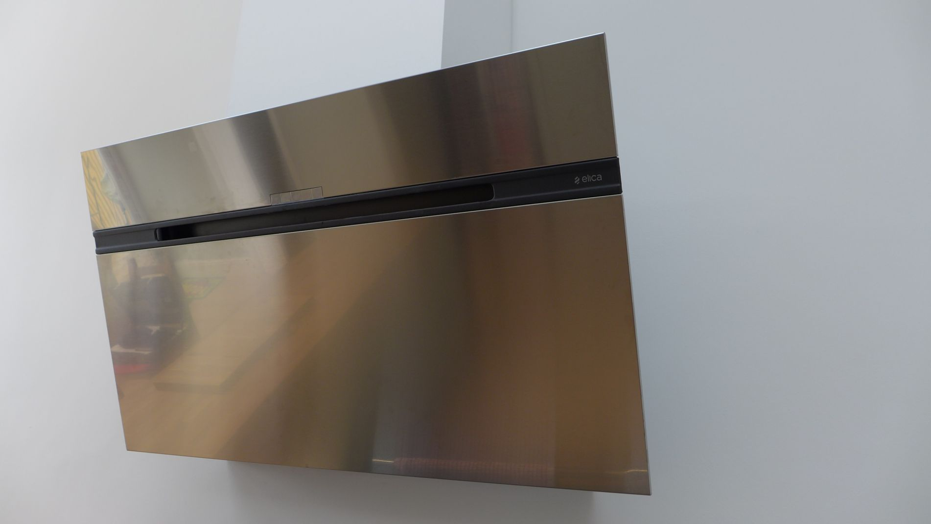 contemporary cooker hood, slanted to give more space for teh cook's head