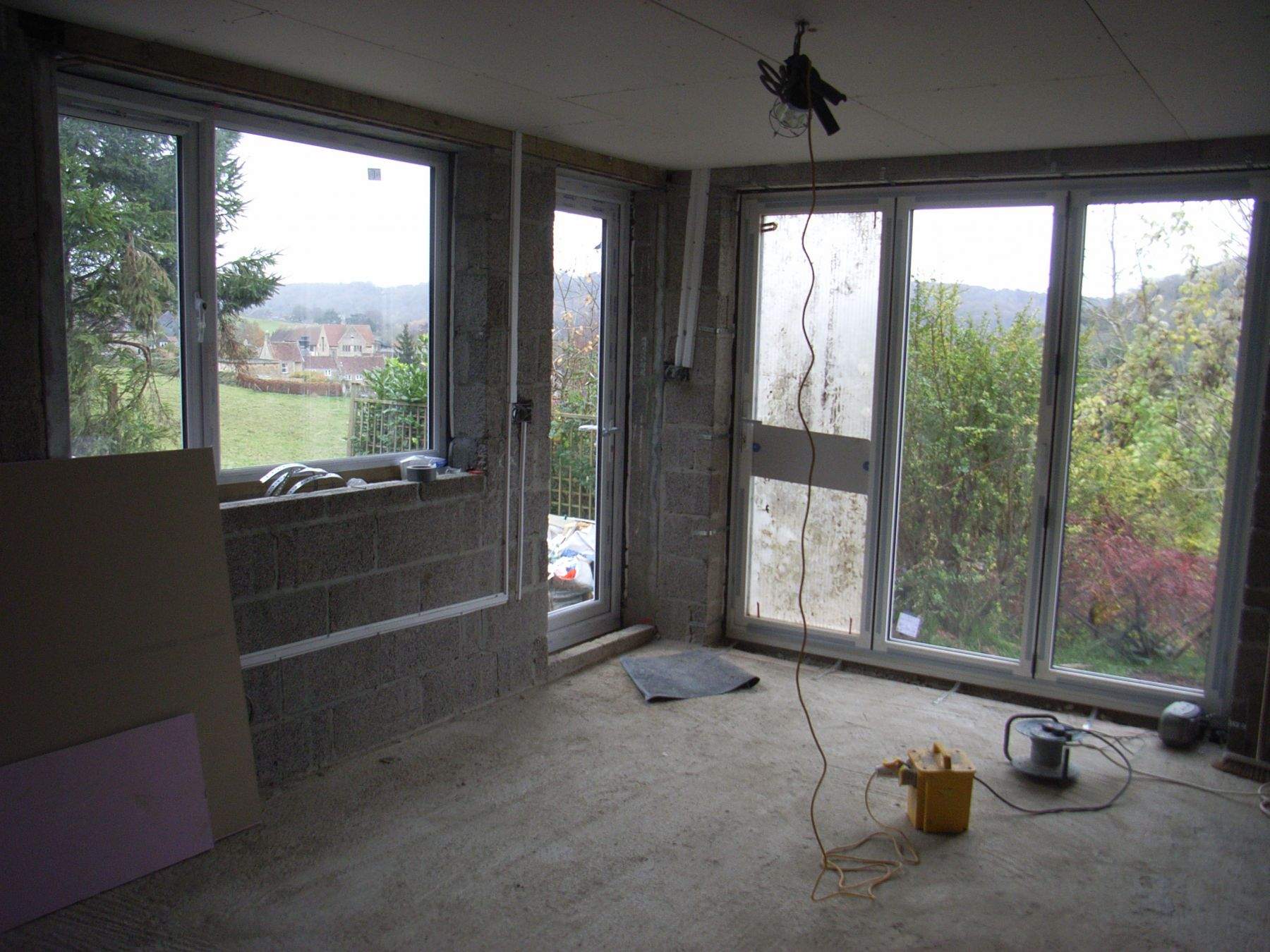 folding sliding doors installed in extension overlooking valley