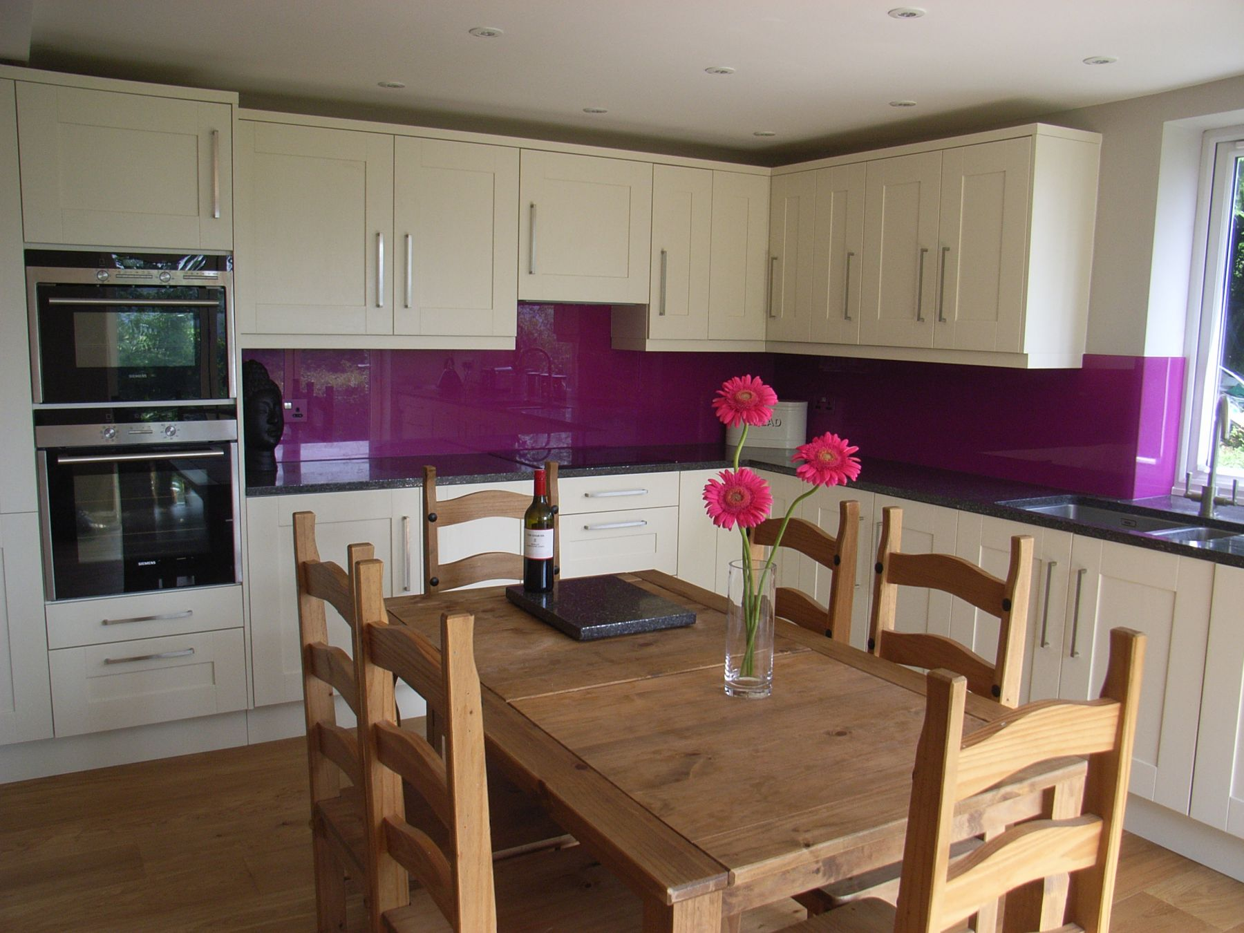 kitchen with purple splashback