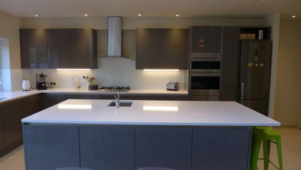 large kitchen island in gloss grey with white quartz worktop