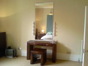 bedroom lighting, here showing a dressing table with make up lighting - like a film star's dressing room