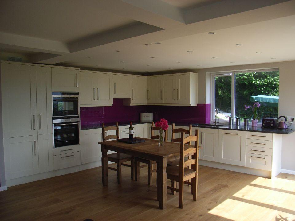 kitchen diner with purple glass splashback