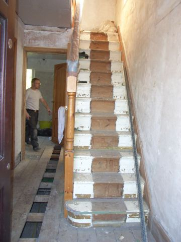 staircase stripped of old carpet and paint