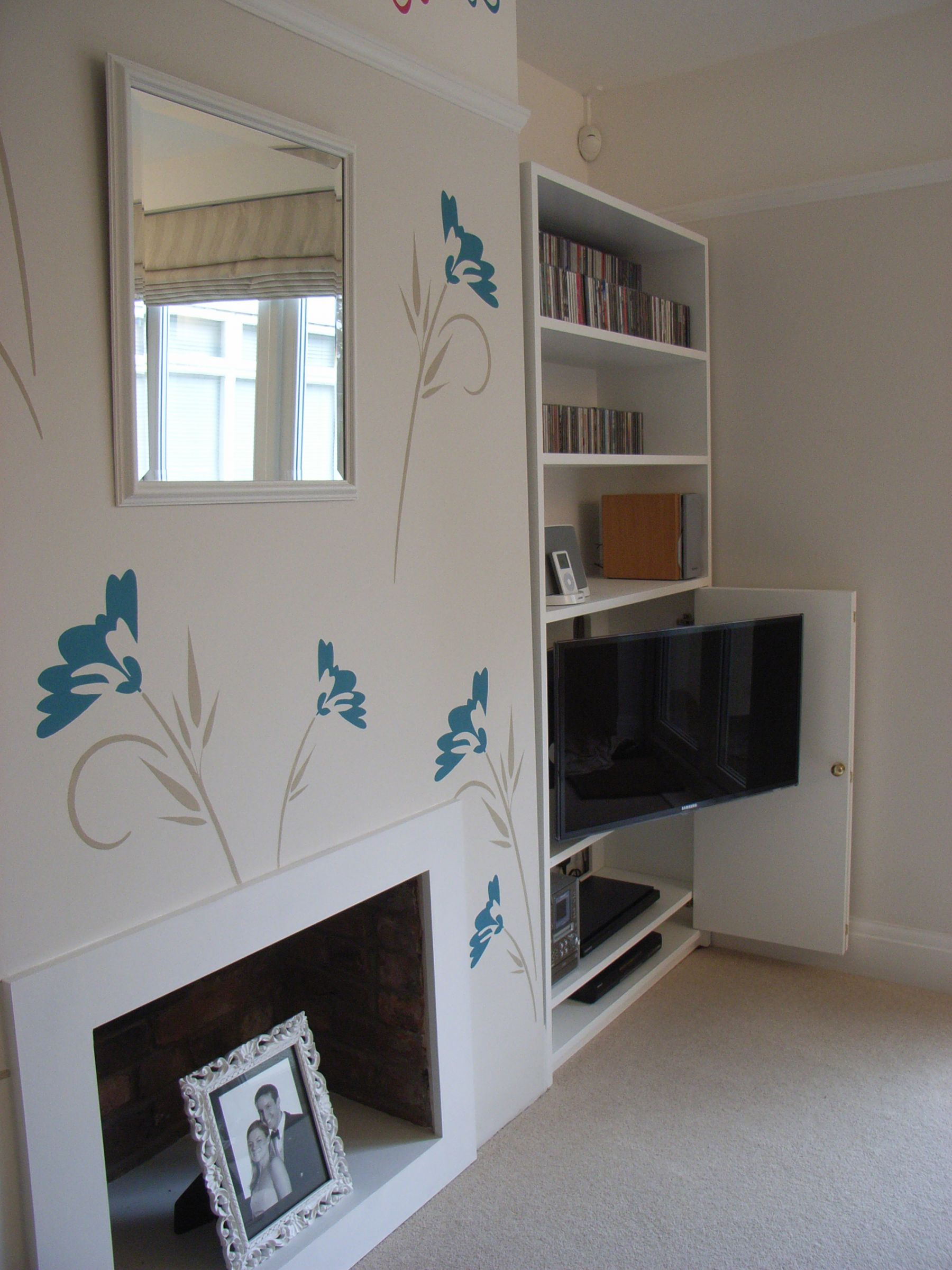 stencilled wall and TV unit