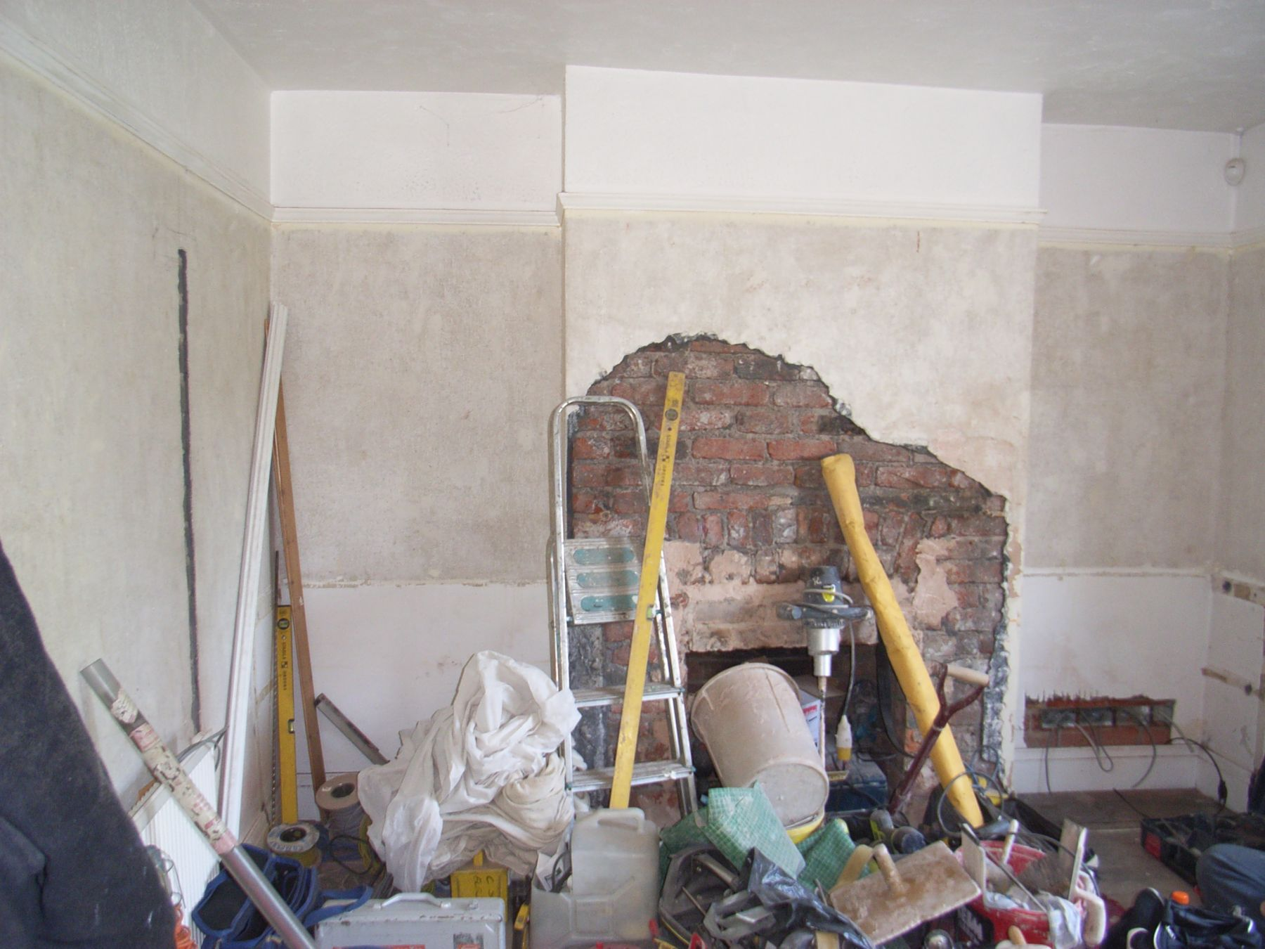 living room walls having loose plaster removed