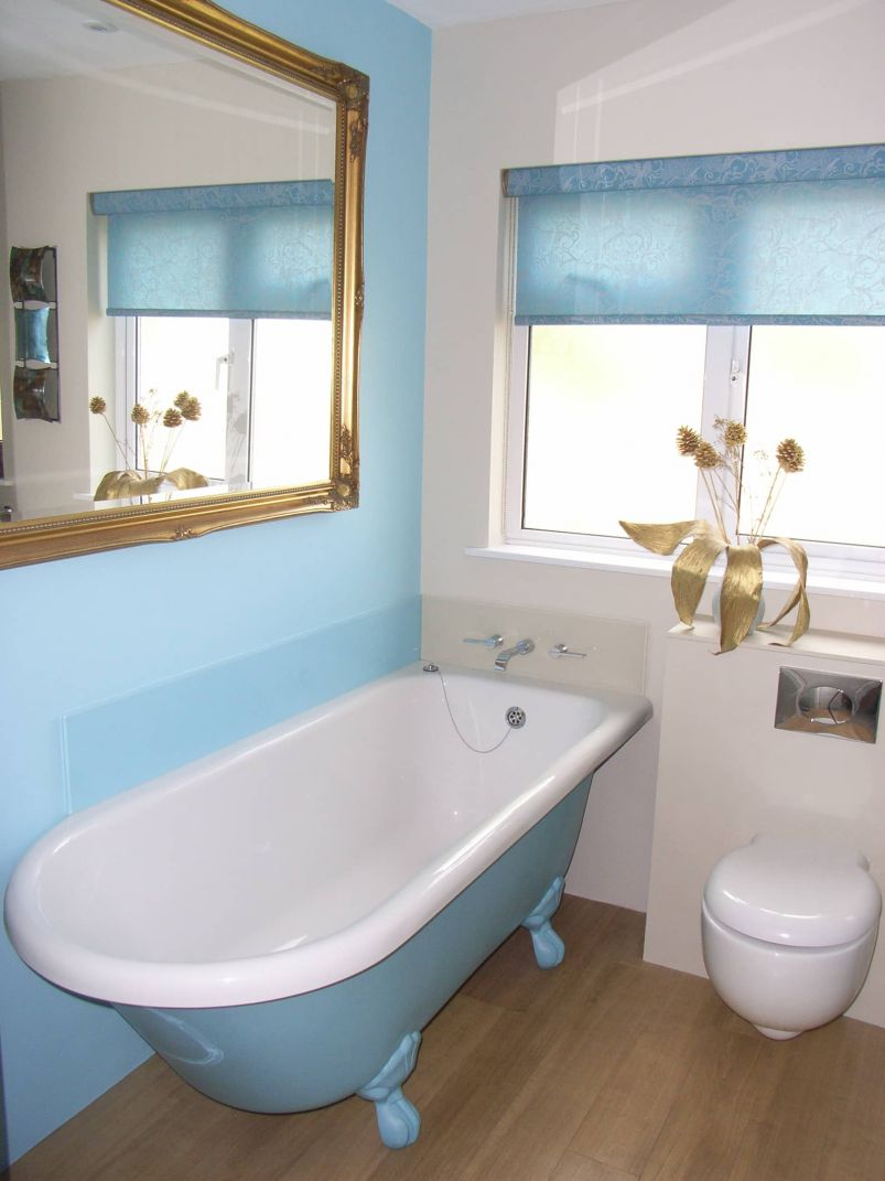 tiled in freestanding painted bath