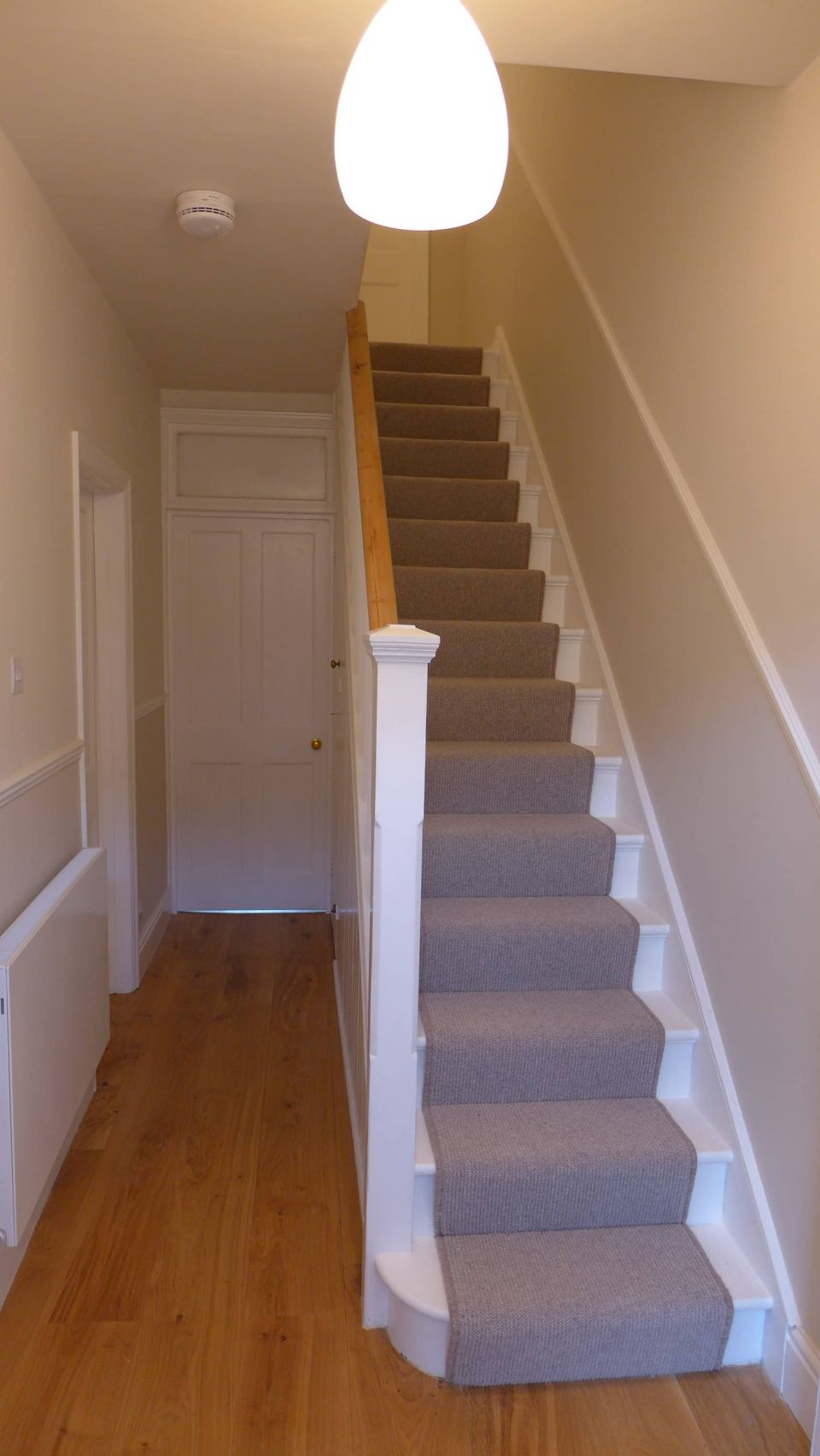 decorated hall and stairway with carpet stair runner after decoration