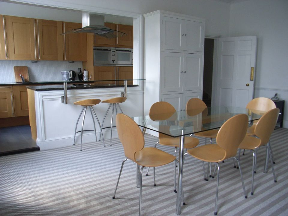 kitchen diner with striped carpet in dining area