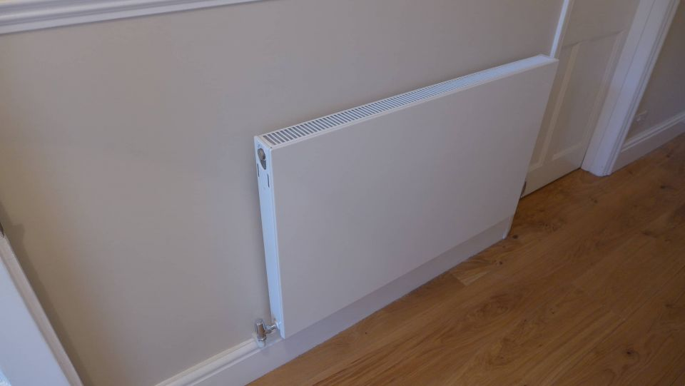 flat low profile radiator painted in with wall
