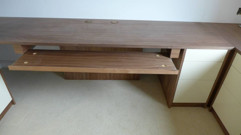 music desk with pull-out keyboard drawer being installed