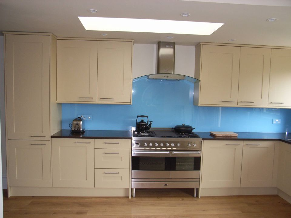 new kitchen with blue glass splashback