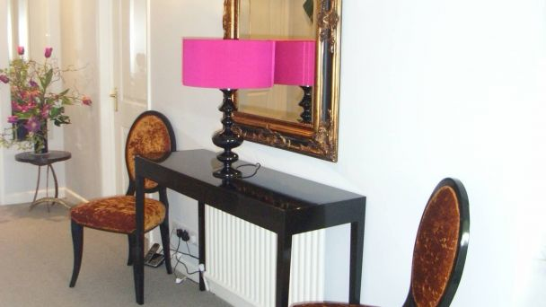 pink lampshade in redecorated hall