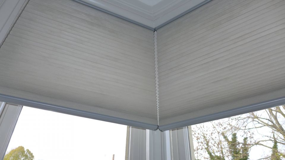 pleated blinds in a bay window