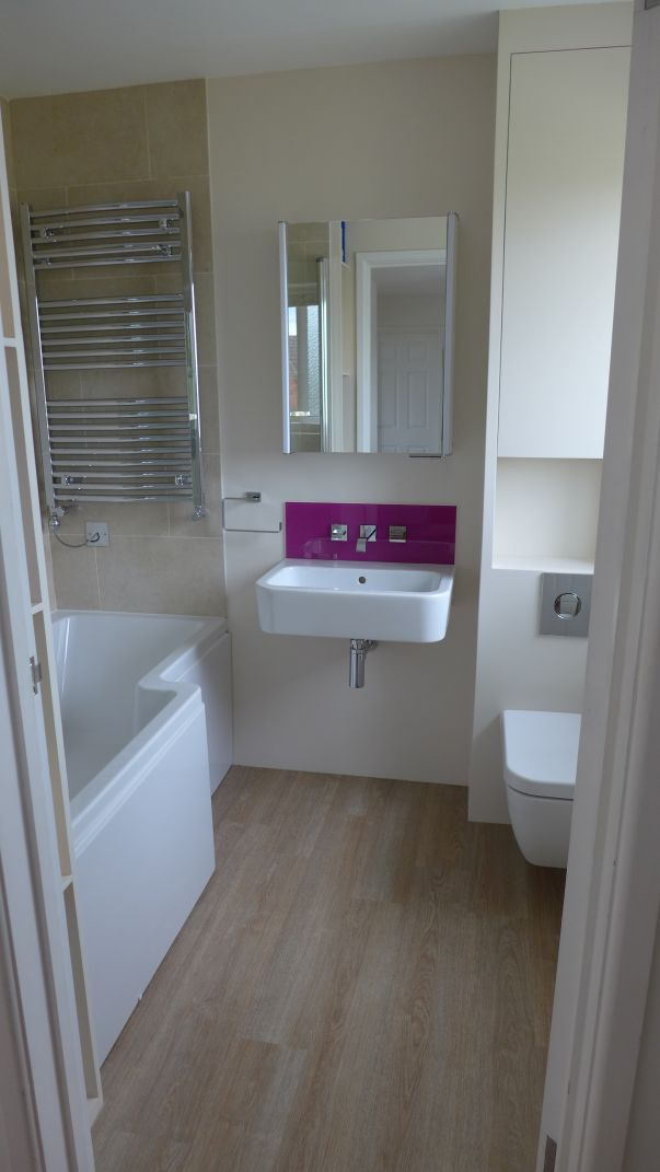 bathroom with purple splashback