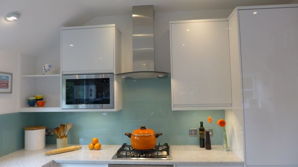 modern kitchen with ice blue glass splashback