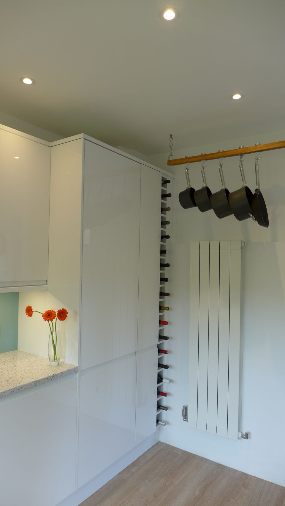 tall wine rack makes good use of narrow space