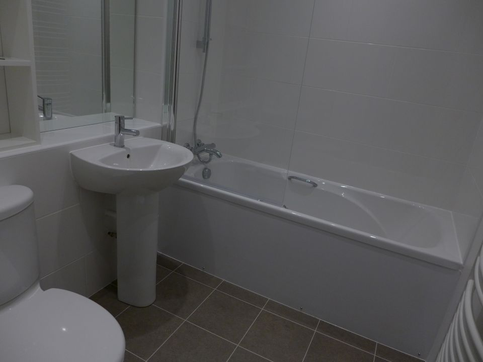 bathroom with vinyl tile flooring