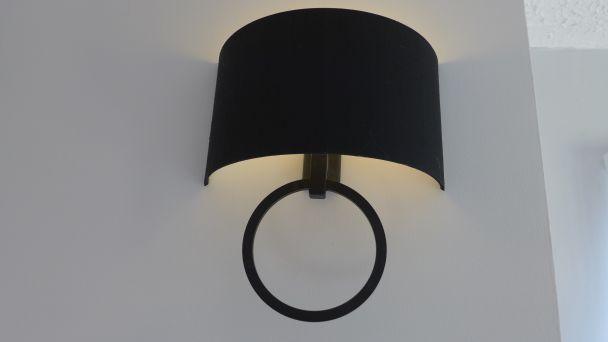 wall light with black silk shade