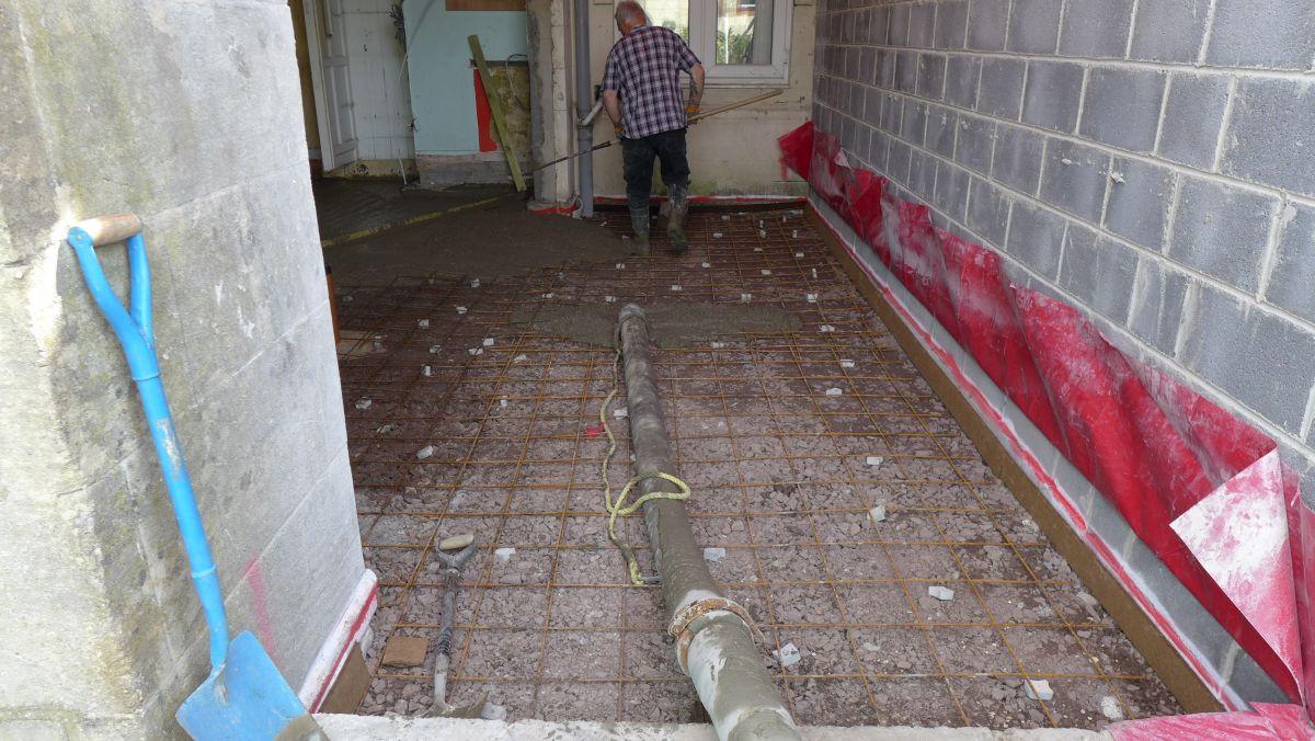 pumped concrete creates new floor slab