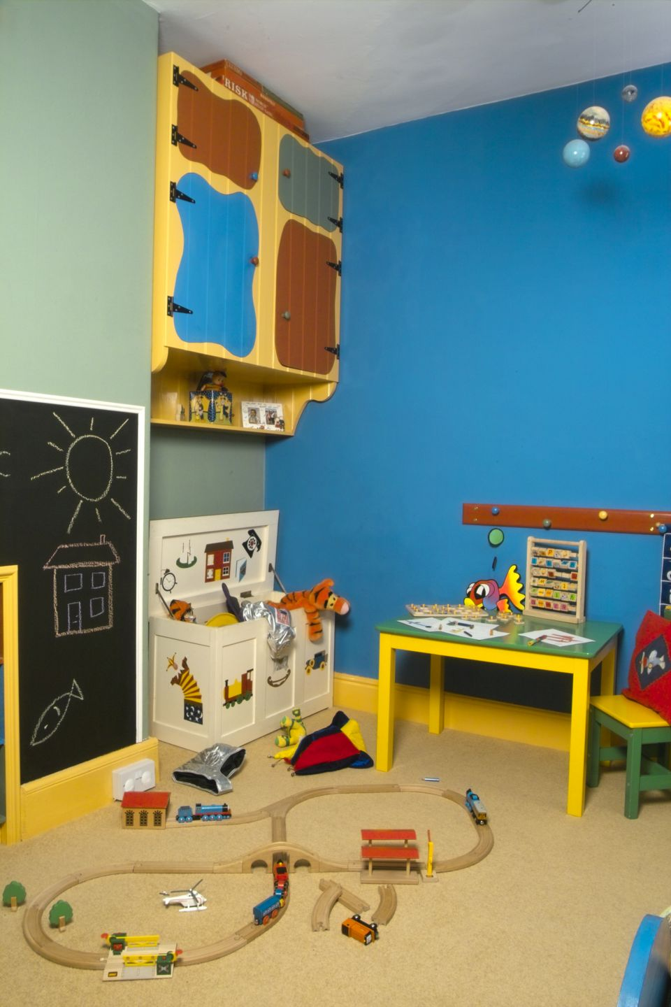 children's rooms can be colourful as here for a toddler, or more warm and cosy for a new born child.