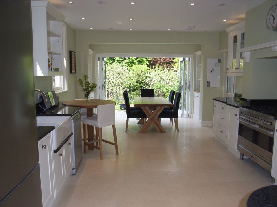 a look at different types of kitchen floors, here a travertine tile leading to the garden room