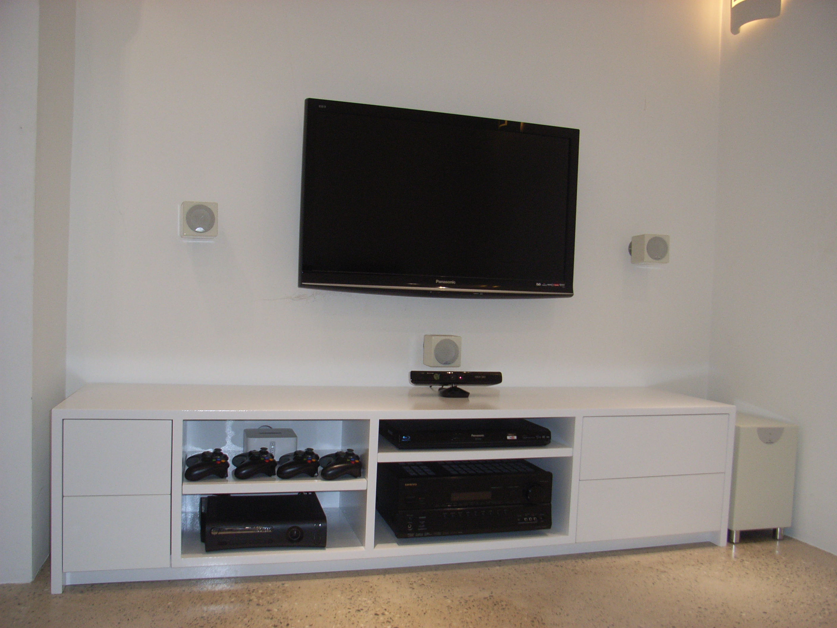 bespoke TV unit with DVDs and Blu Rays in push to open drawers