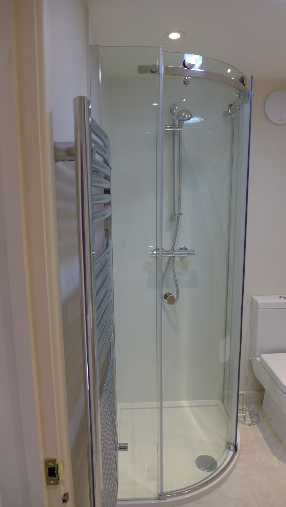 quadrant shower in small attic en suite