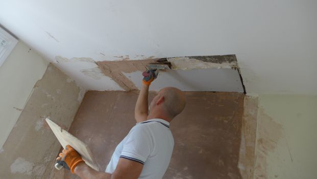Plasterboarding and plastering ceiling