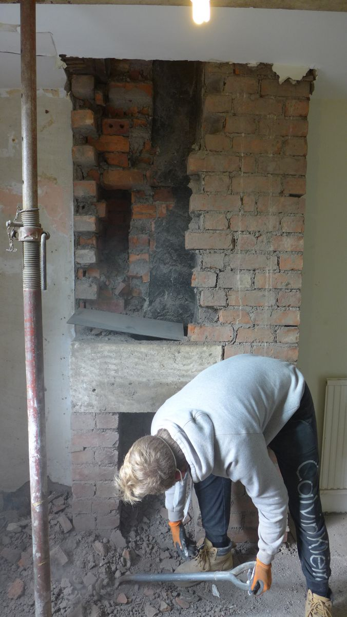chimney breast being dismantled