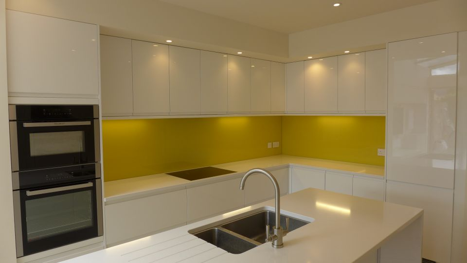 yellow glass kitchen splashback