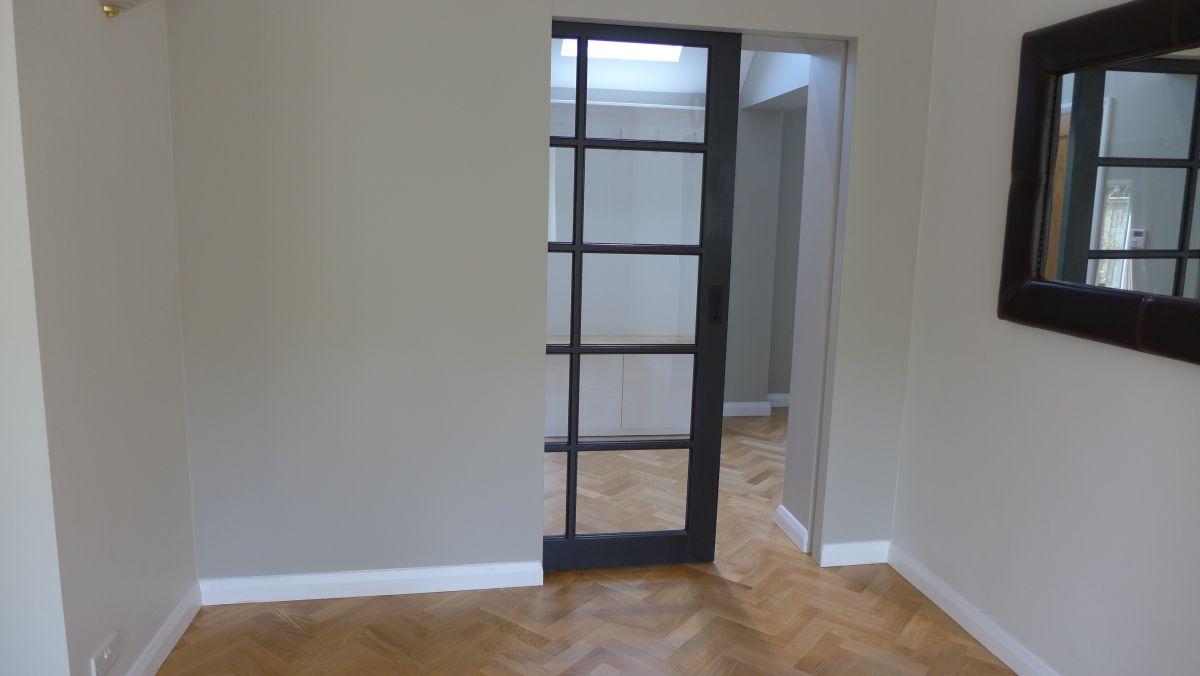 glazed pocket door opening
