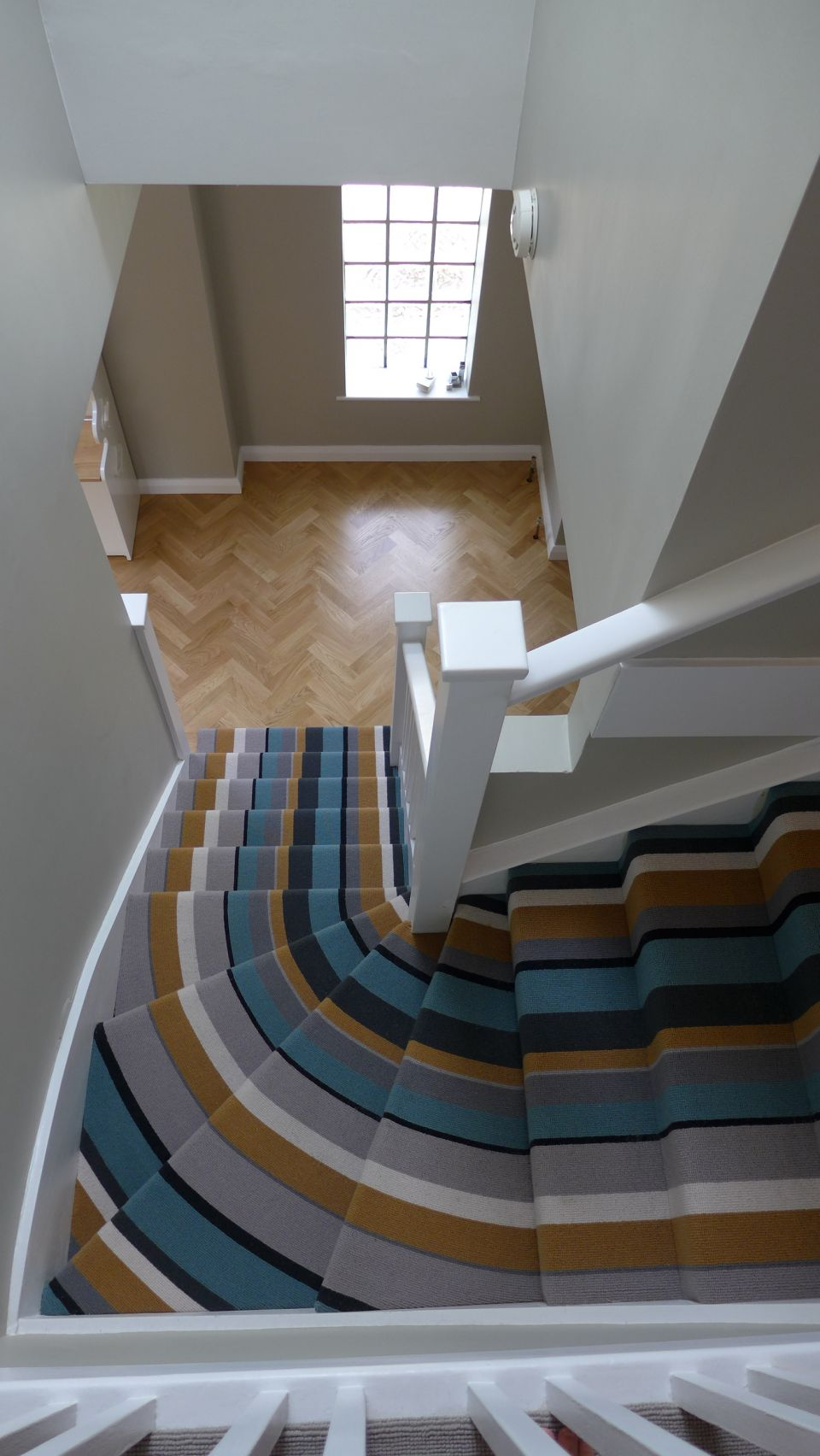 striped stair carpet to parquet hall floor